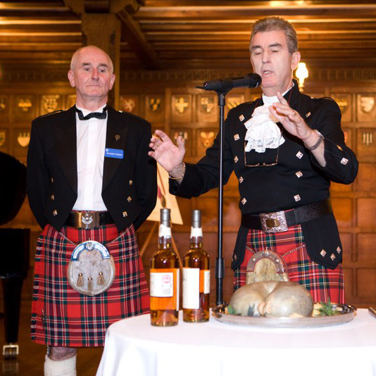 Glen in action addressing the Haggis