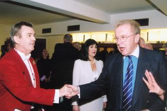 Glen seen here with Sir David Frost